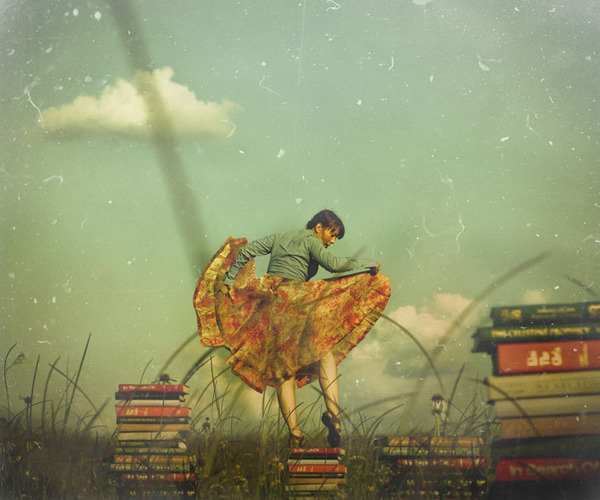brooke-golightly-photography-texture-brunette-girl-woman-standing-books-clouds-blue-sky-dress.jpg