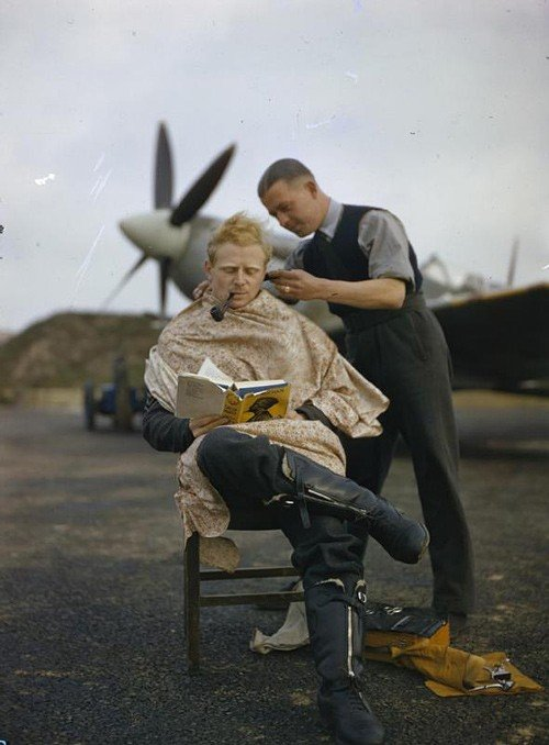 An Royal Air Force pilot getting a haircut during a break between missions, Britain, 1942.jpg