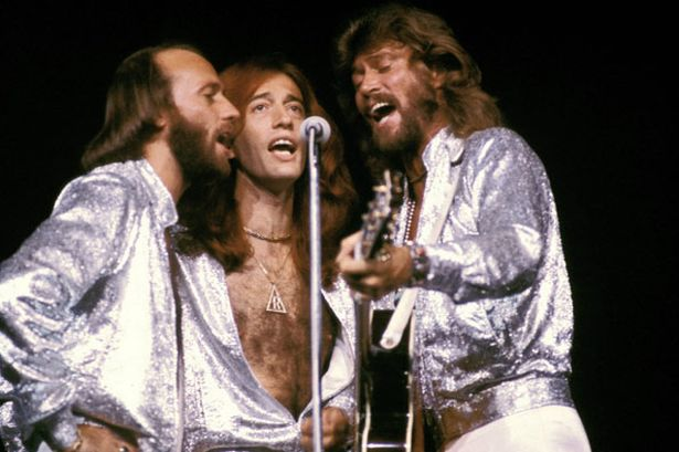 maurice-gibb-robin-gibb-and-barry-gibb-of-the-bee-gees-performing-in-madison-square-garden-september-1979-pic-pa-876949633-87676.jpg