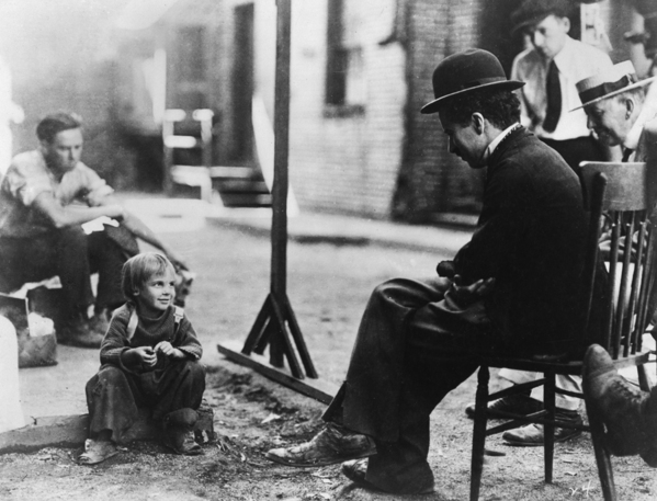 charlie chaplin with jack coogan on the set of the kid.jpg